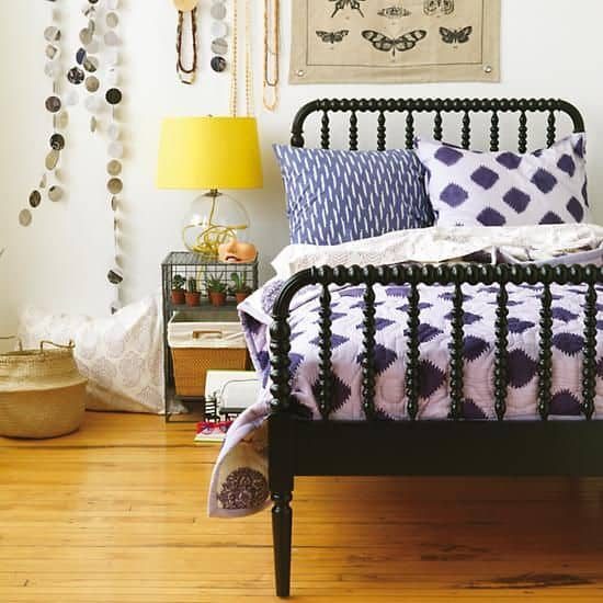 The modern farmhouse staple: the antique black bed to complete your bedroom makover.