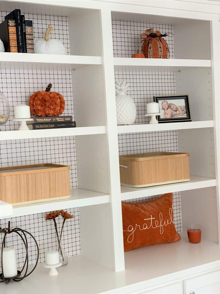 DIY bookshelf makeover: $2 wrapping paper